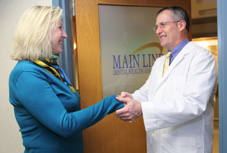 Dr. Snider greeting patient