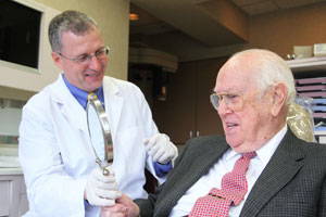 Older man receiving consultation from Dr. Snider